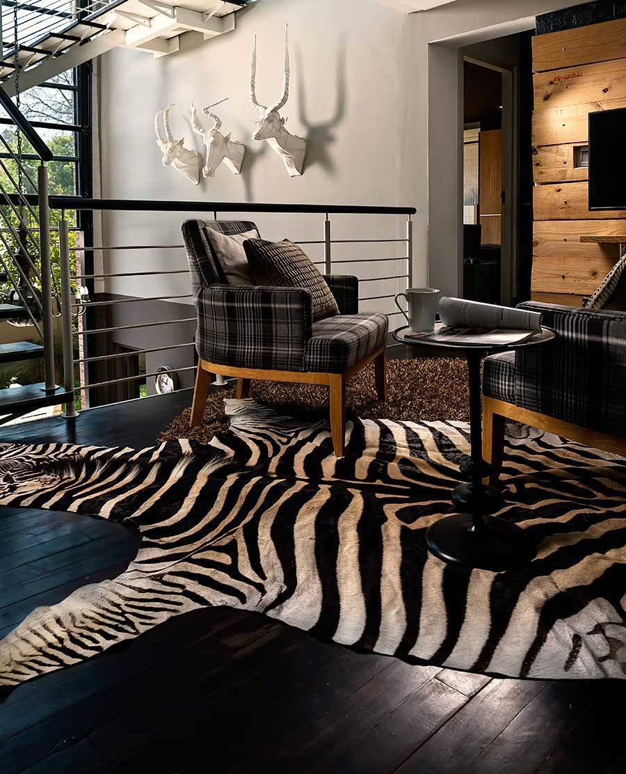 Zebra rug slide in a home decor setting