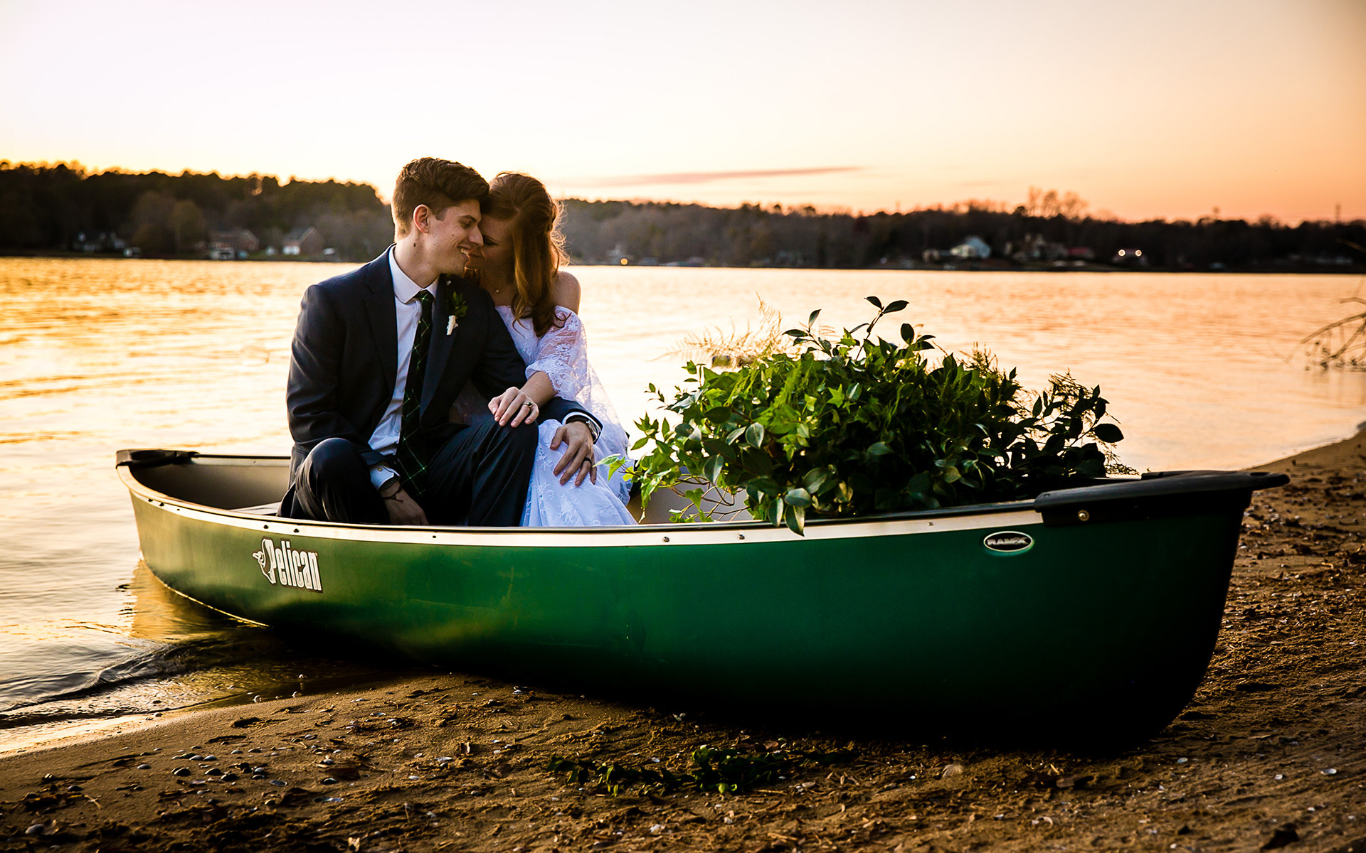 A Sunset Canoe Entrance to a Camp Themed Styled Shoot