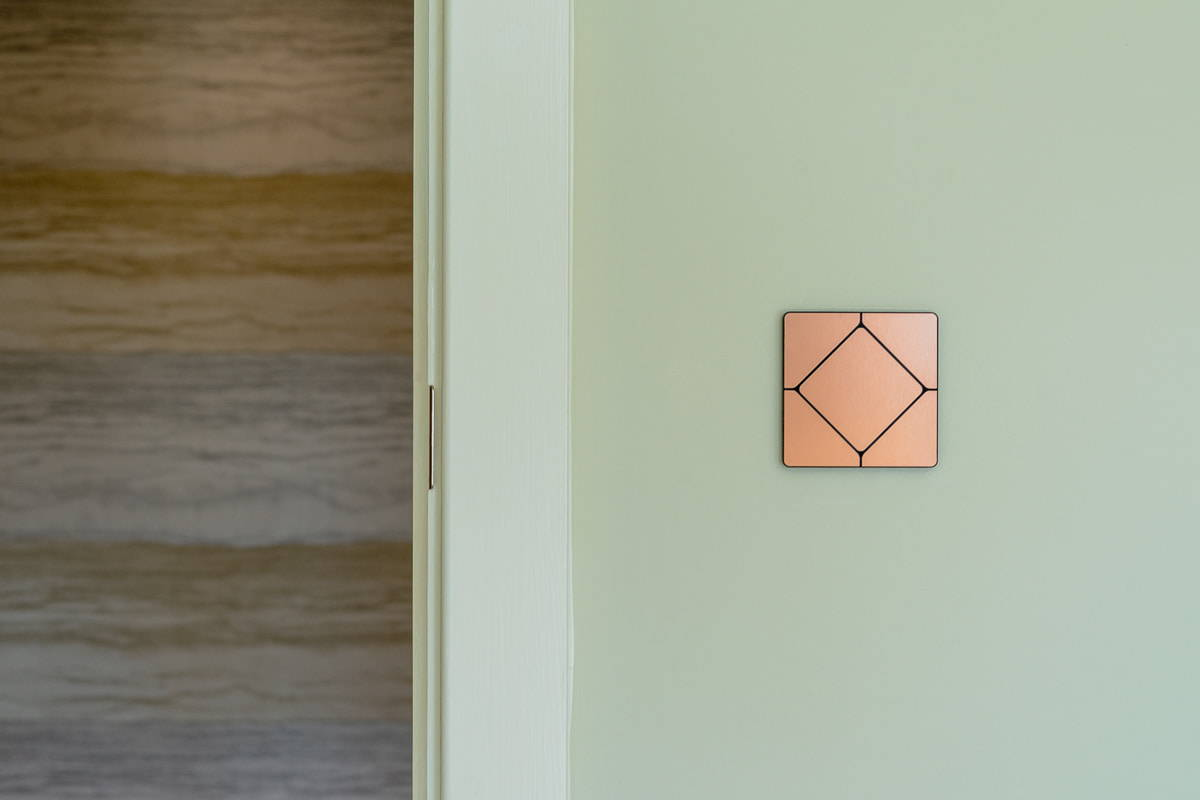 Faradite TAP light switch in brushed copper on a Loxone smart home