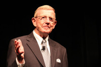 Coach Lou Holtz razzed TD Ameritrade's Rey Pajarillo, telling him: Keep the intro short!