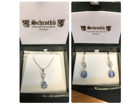 Pair of Earrings & a Necklace from Schroth's Gold and Silversmiths Jewelers