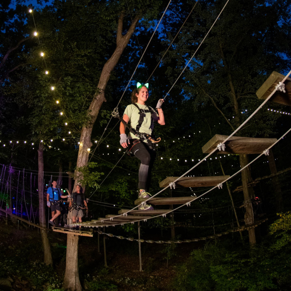 Picture of Enjoy a magical experience at The Adventure Park. Climb and zipline through the trees – literally aglow – with colored lights, laser lights, music, and more.