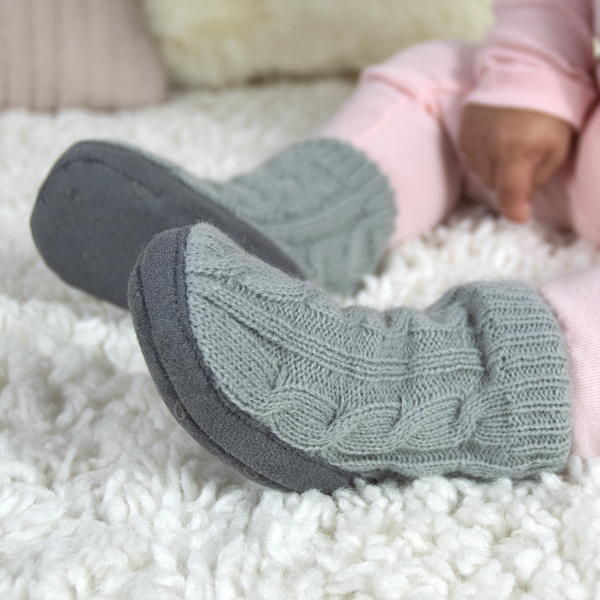child with infant girl slippers
