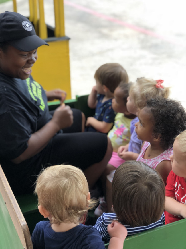 Ms. MeeCee and here toddler class are thrilled to ride the trackless train that visited Primrose School of Old Orchard.