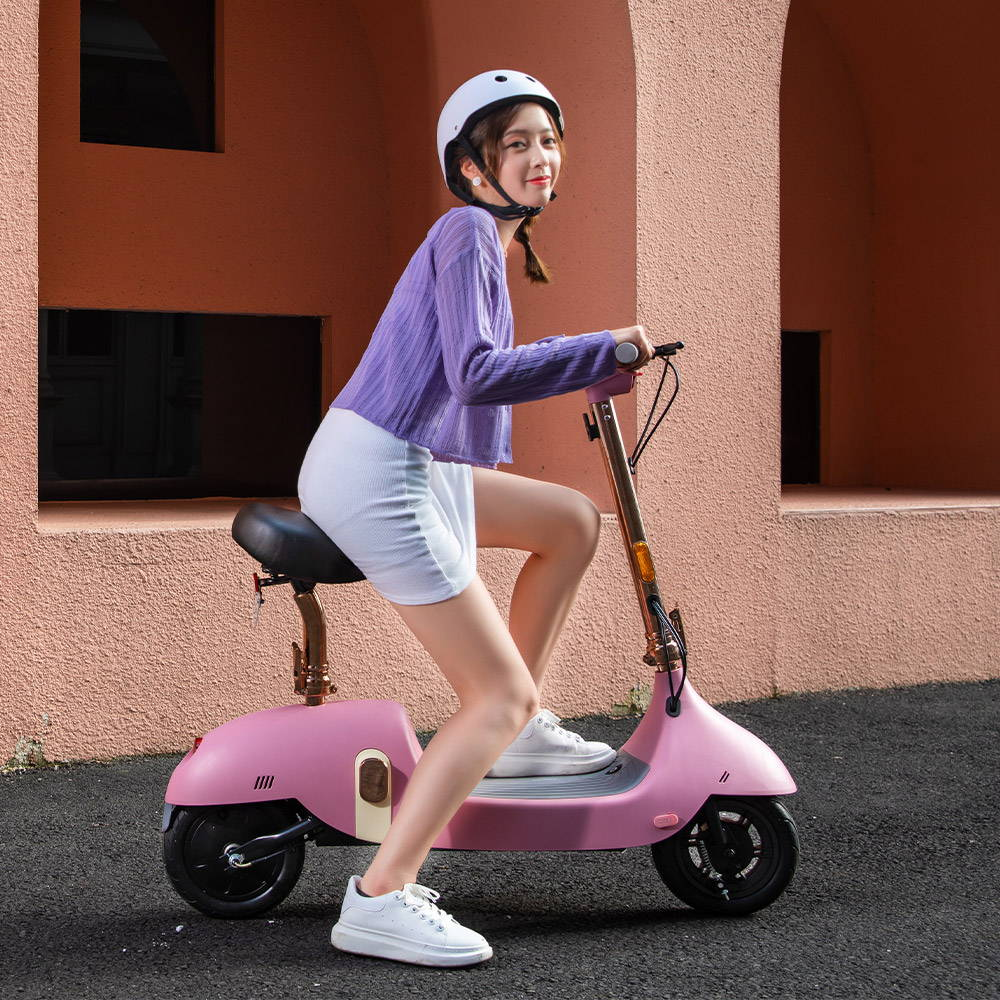 okai ea10 escooter girl happy riding pink scooter