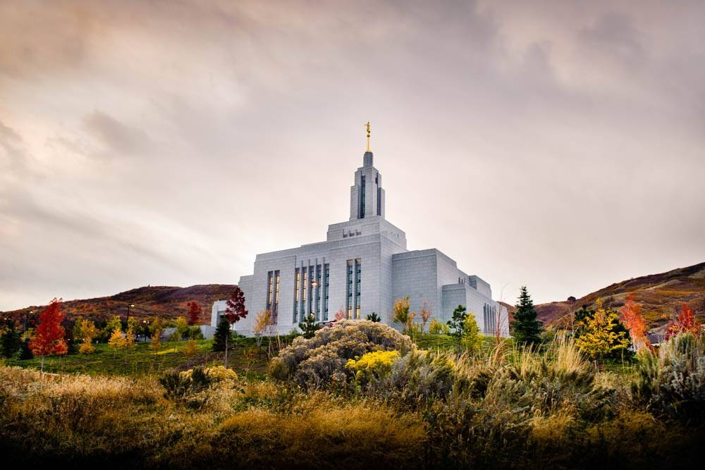 Photo of Draper Utah LDS Temple among autumn trees.