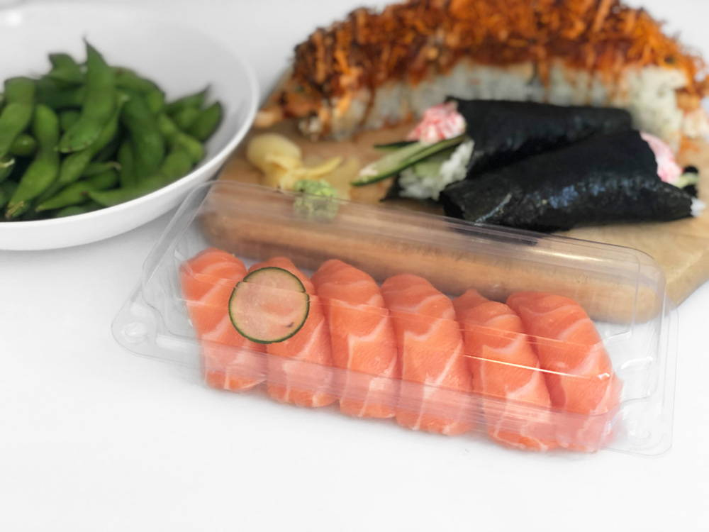 compostable deli container with 6 nigiri sushi elegantly diagonal