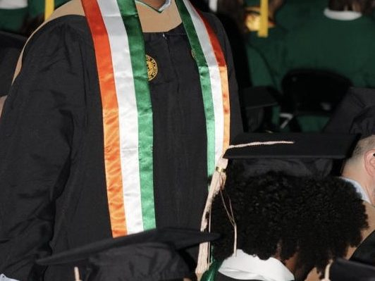 RENTERS BAY: USF Muma college Masters graduation gown . Pick it up today
