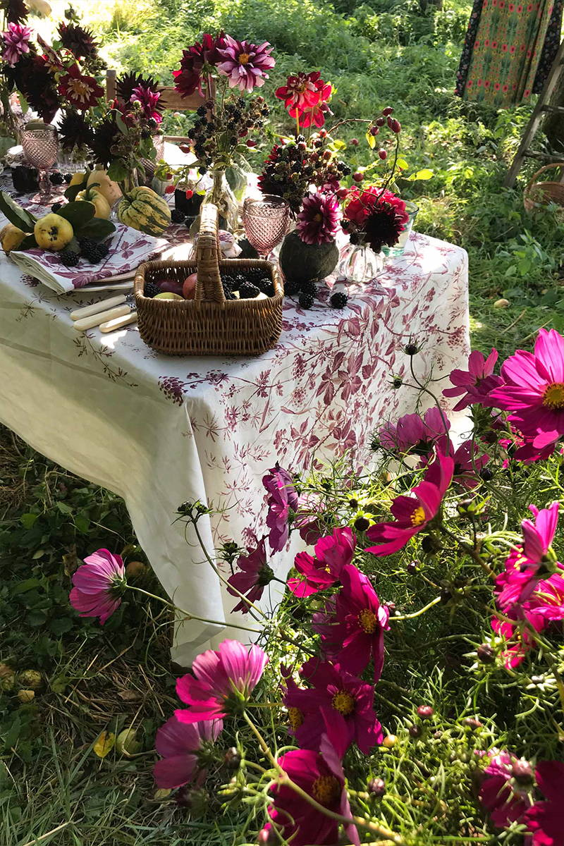 Tablescape featuring YOLKE's Blackberry Print Linen Tablecloth and Kitten Grayson Flowers