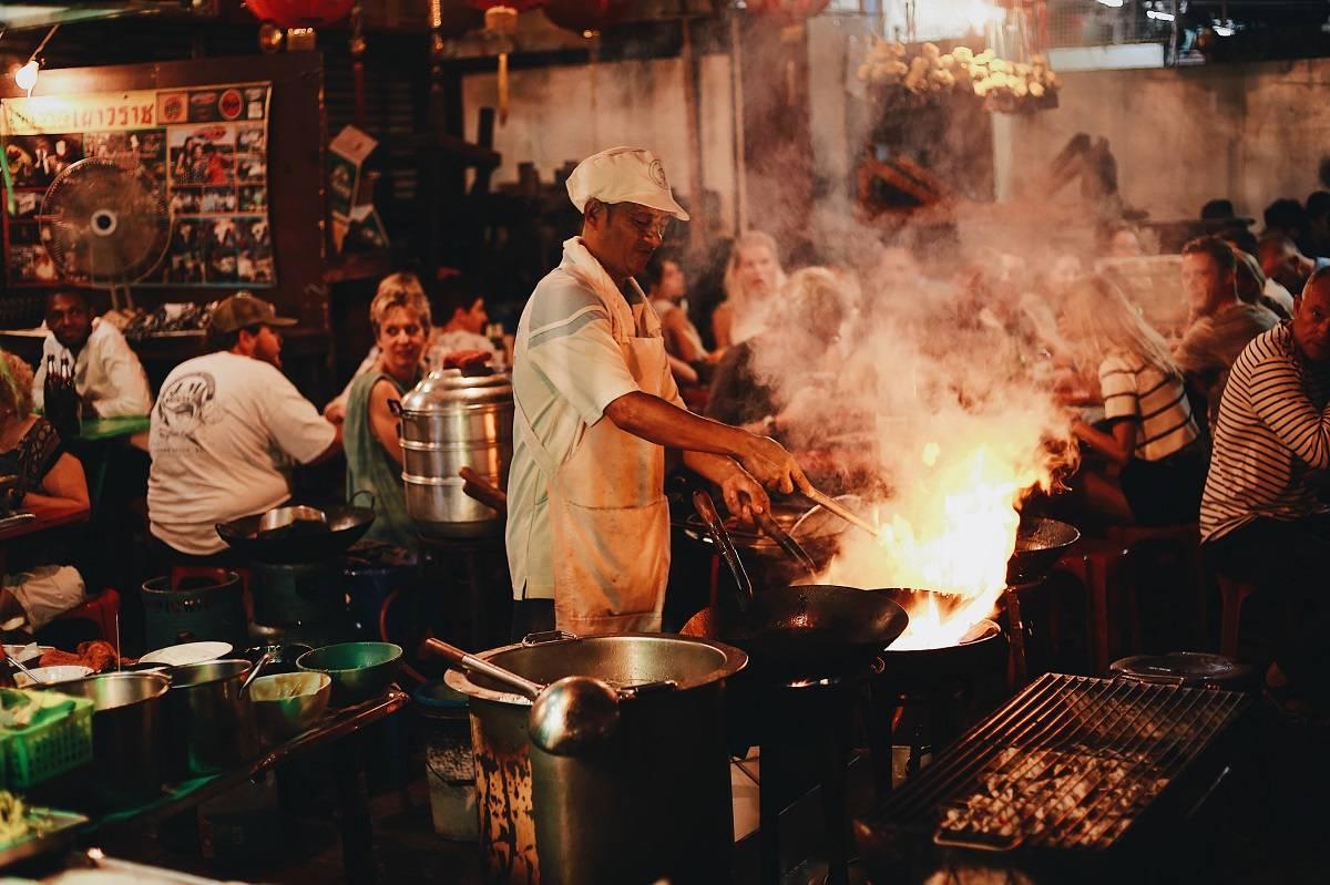 Street food being prepared at yaowarat road in Bangkok, Thailand where the national food is pad thai
