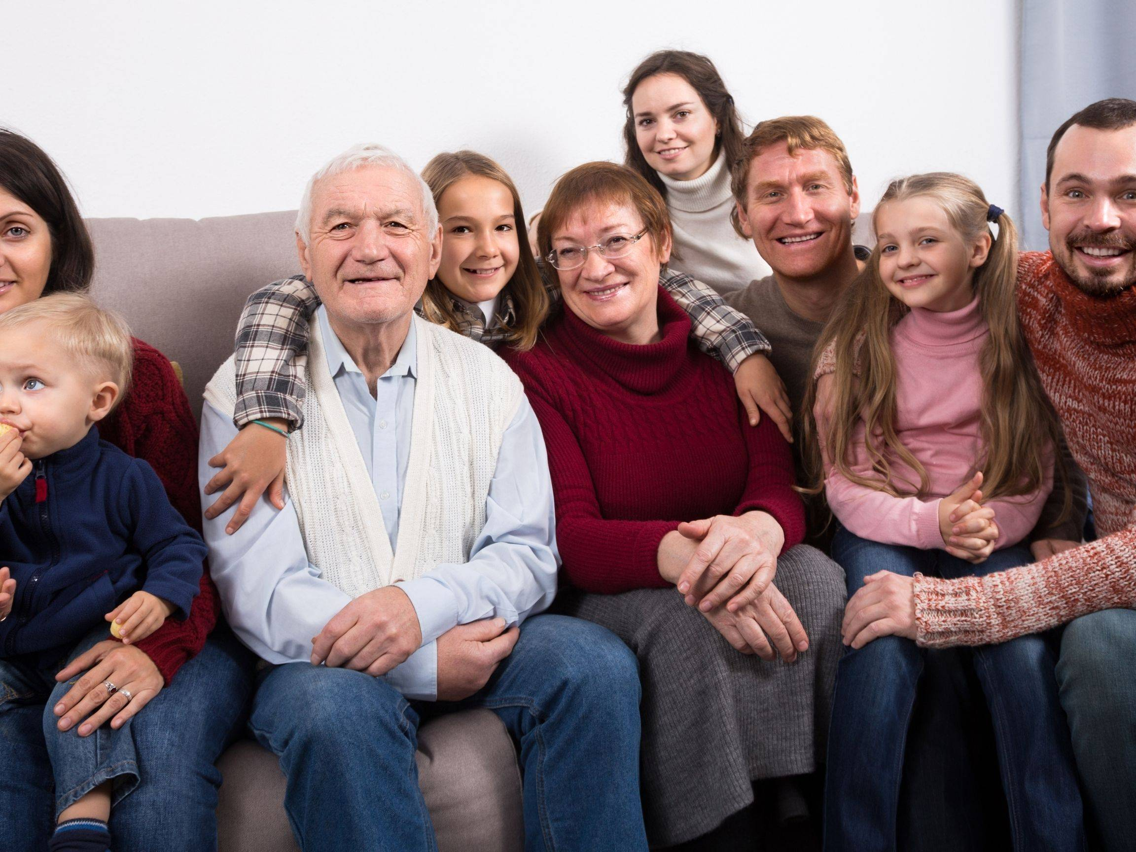 Extended family sitting together and surrounding Dad