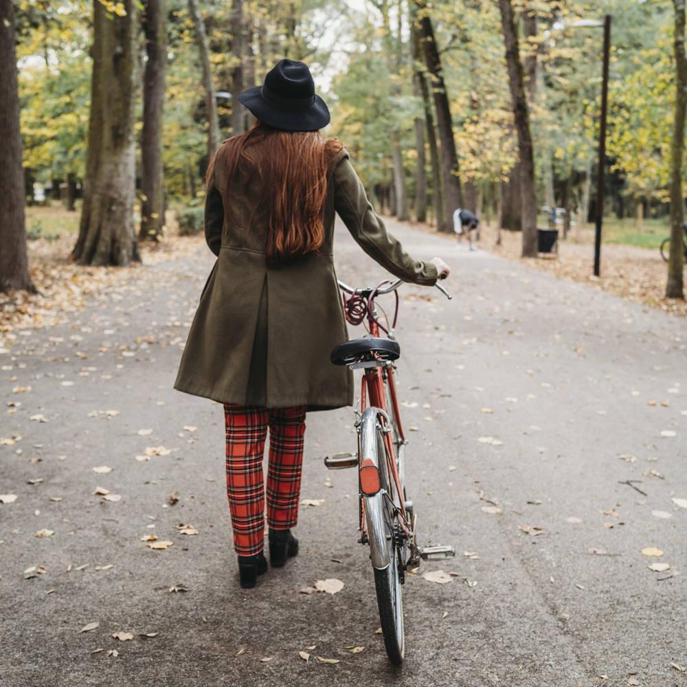 Woman on bike in park