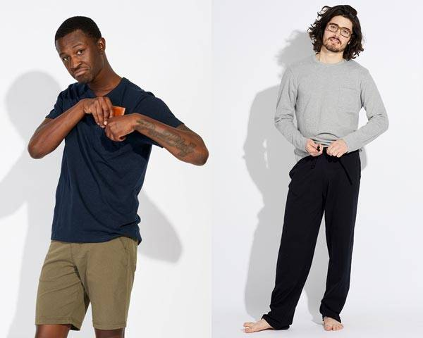 Man wearing navy blue organic cotton t-shirt with olive shorts and man wearing grey long sleeve t-shirt with black drawstring sweatpants
