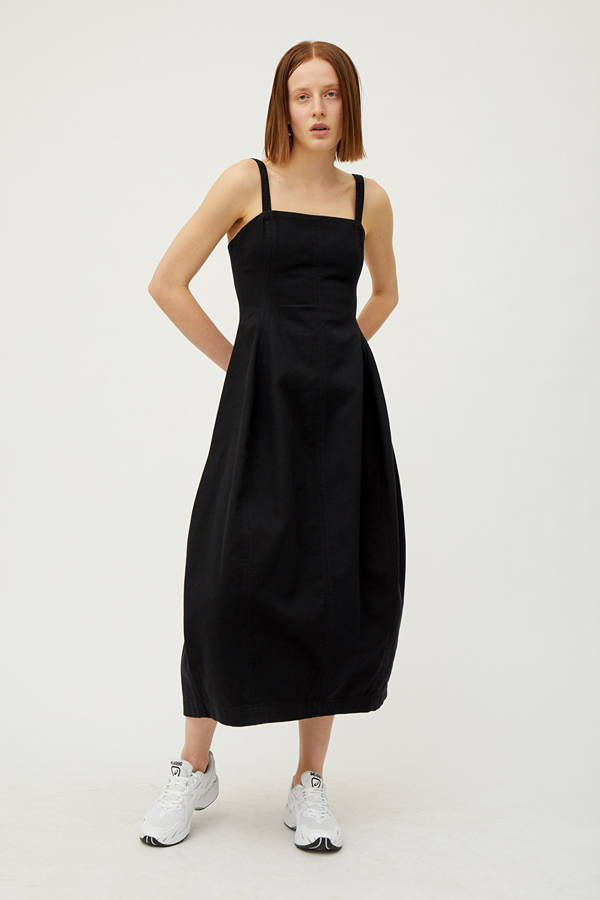 Front of woman wearing black organic cotton dress
