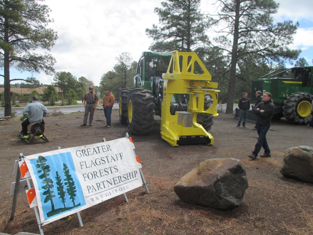 GFFP banner and a feller buncher were two of the first things that event attendees saw when entering the forest restoration and harvesting methods showcase.