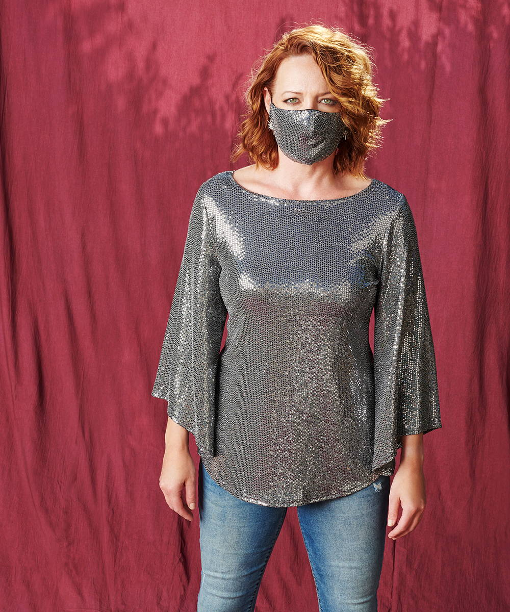 woman wearing silver sequin caxlz foxy tunic top and matching silver sequin mask from lawrence zarian and connected apparel