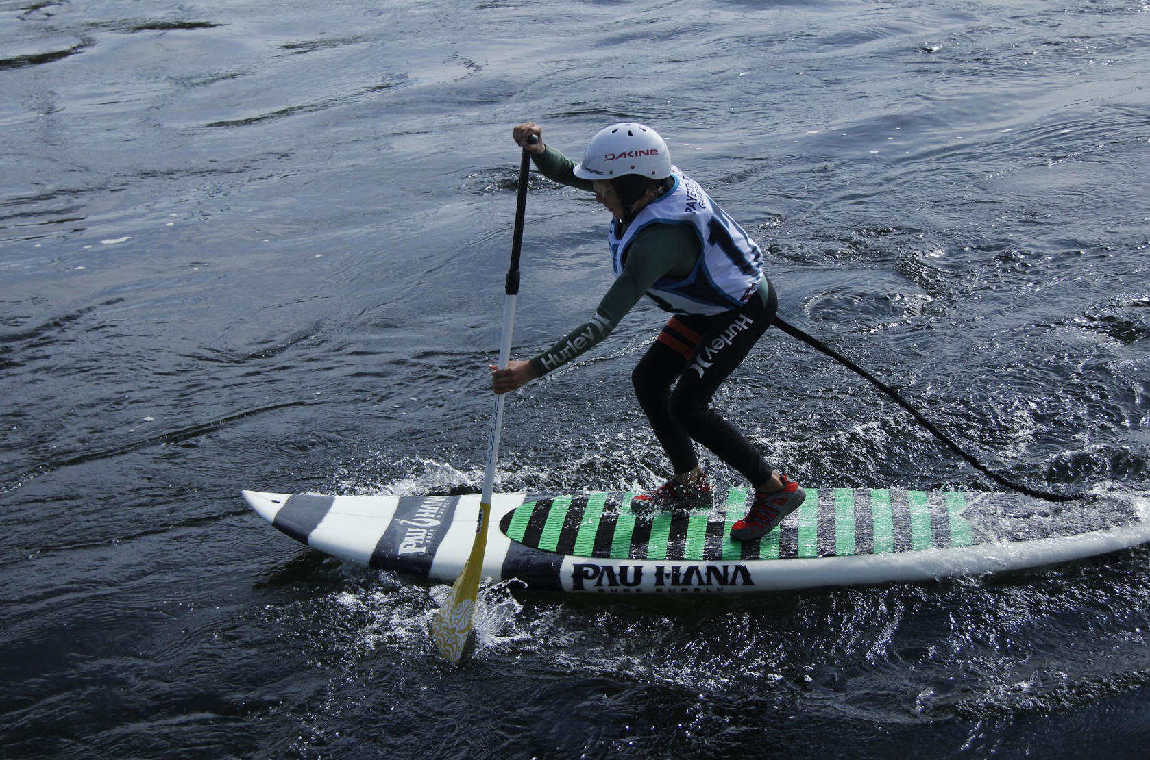 Sup river surfing on the Pau Hana surf supply white water board