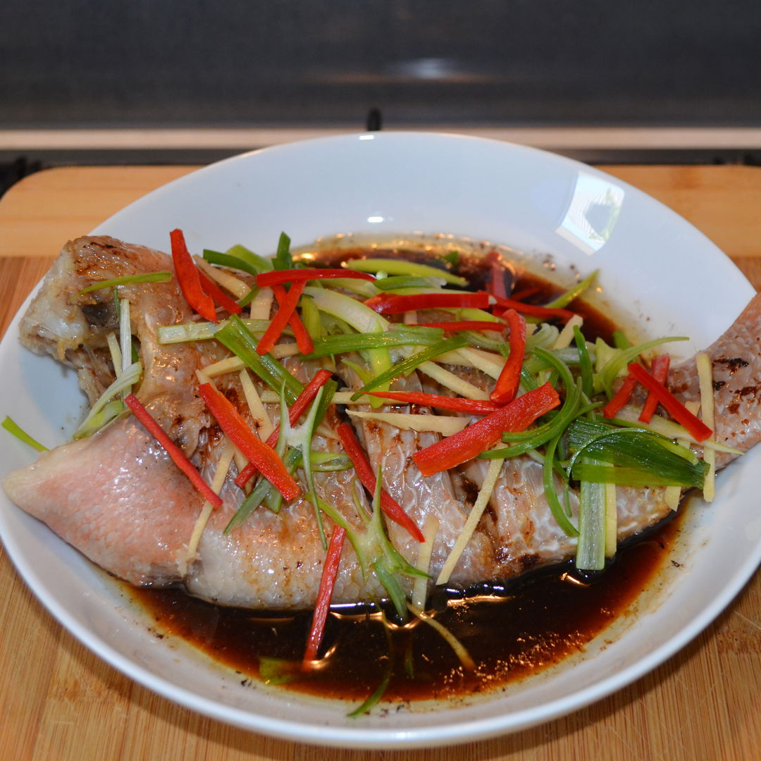 Date: 17 Feb 2020 (Mon) 31st Side: Steamed Fish (Cantonese Steamed Fish) - Red Tilapia [227] [146.0%] [Score: 10.0] Cuisine: Malaysian, Singaporean Dish Type: Side In many Chinese families, steamed fish are always listed top of their most cooked recipes. Steamed fish with ginger and spring onions is one of the easiest and best steamed fish recipes. There are many reasons why steaming the fish is preferred over other methods of cooking. Firstly, it is much healthier and secondly, most of the nutrients of the fish are retained. Fresh white fish is best-suited for this recipe and today's fish of choice is Red Tilapia.