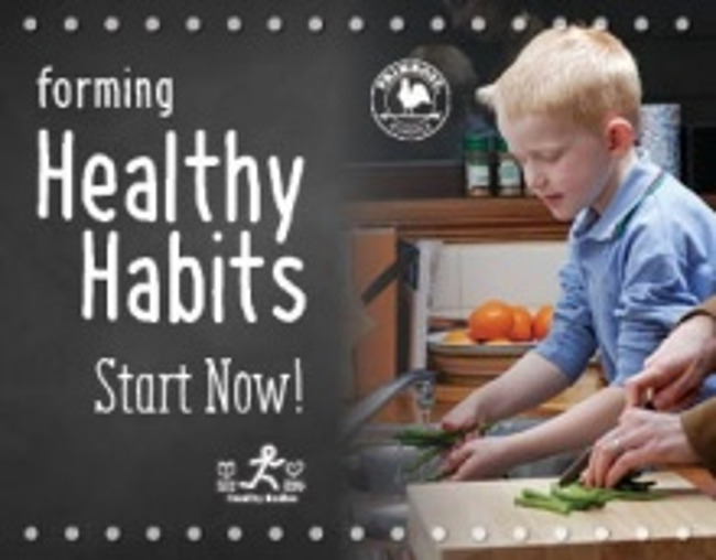 Healthy habits poster featuring a young boy helping his mother for dinner by washing the vegetables