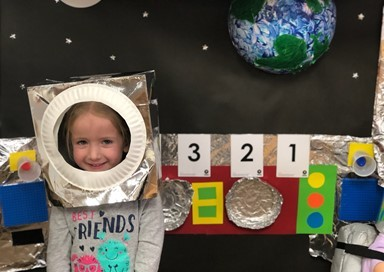 Image of little girl dressed as an astronaut