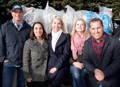 Bryan and Sara Baeumler donating mattresses with Haven Mattress