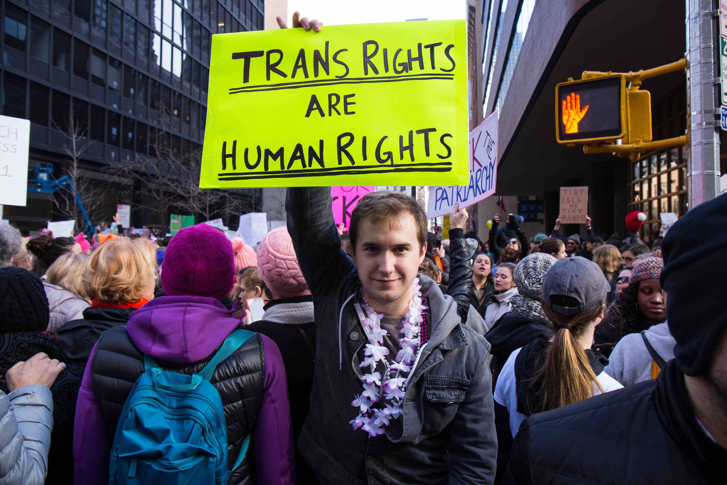 Trans campaigner with placard