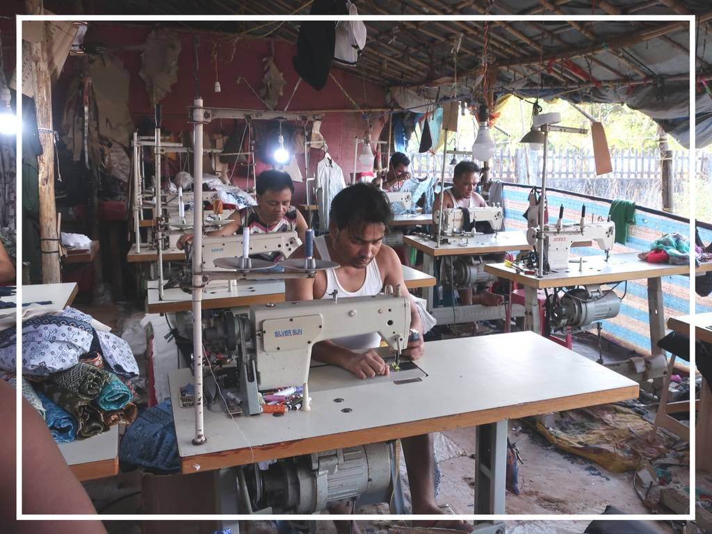 workers in a factory in india sewing