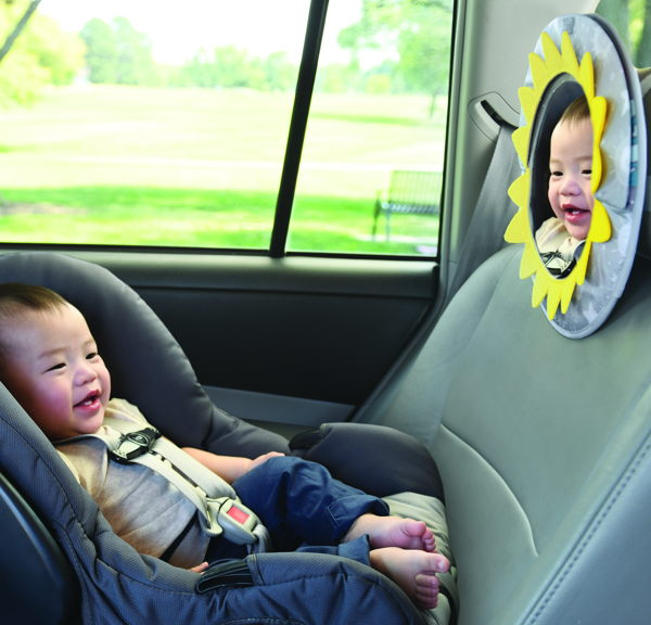 child with travel mirrors