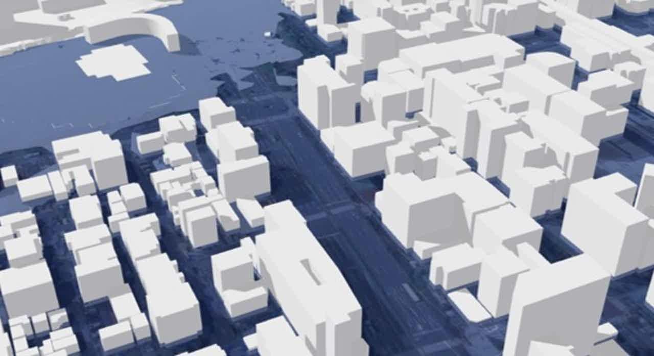 浸水想定区域図を3D都市モデルに重ねたイメージ(出典:国土交通省)