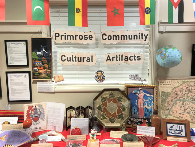 table with artifacts that Primrose families provided from their personal culture with written descriptions of the items