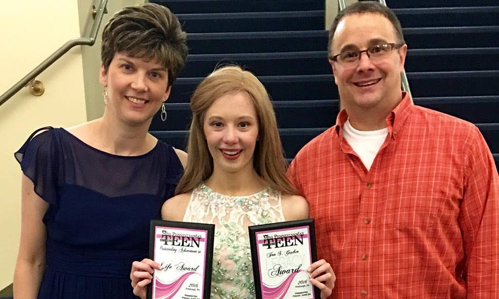 Hair Club For Kids Client Sarah Pennington with her parents