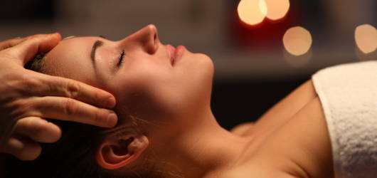 woman relaxing during a head massage