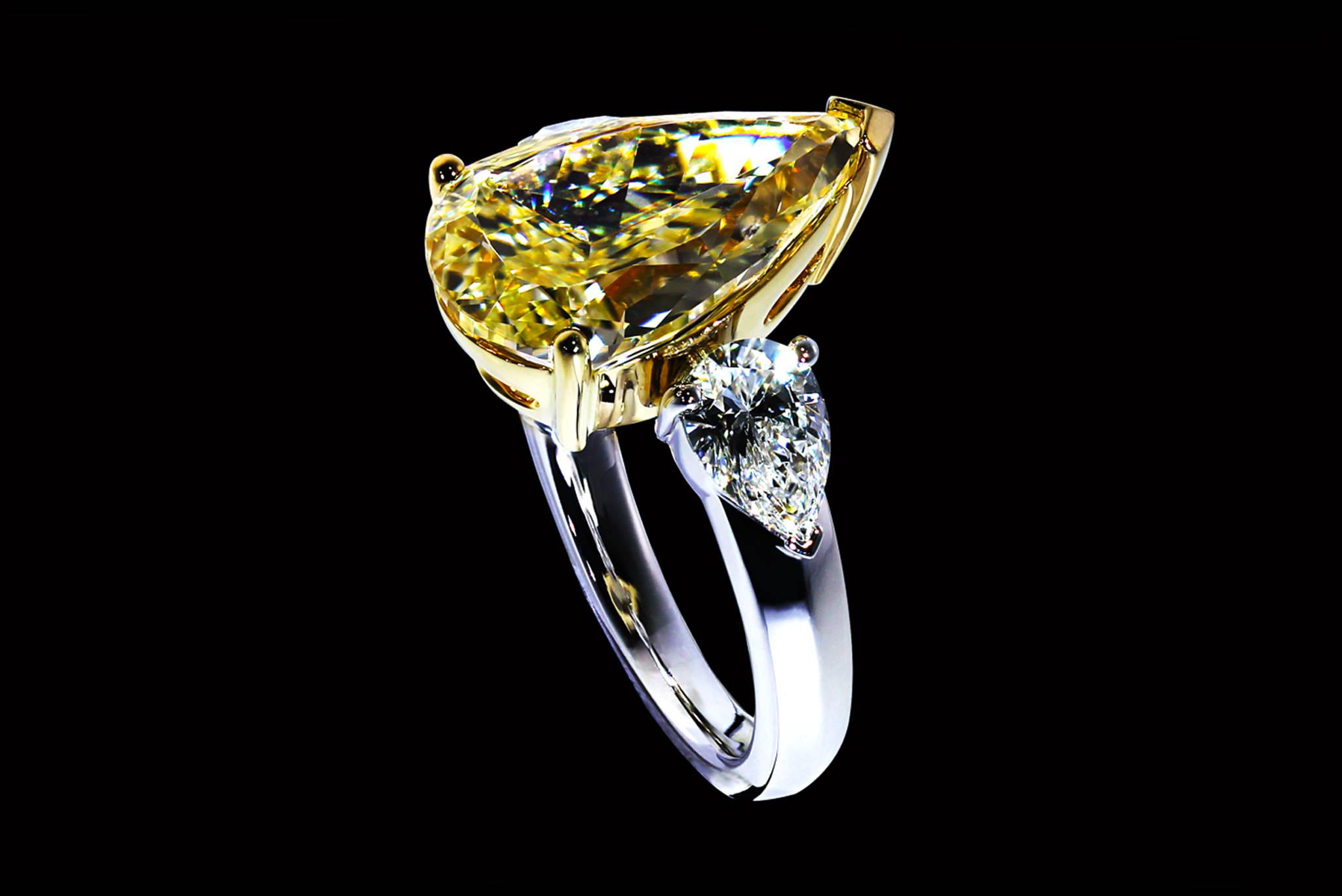 Fancy Intense Yellow Pear Shape Diamond Ring degrees view
