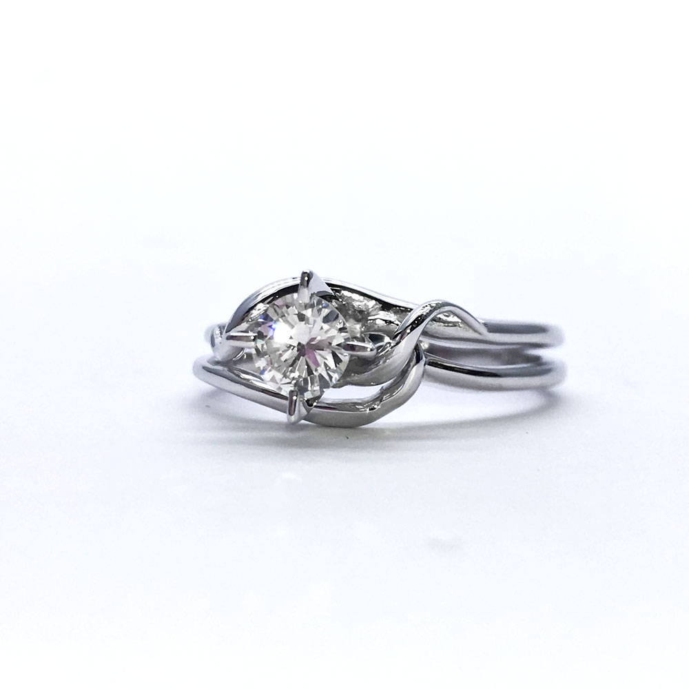 Solitaire custom ring with medieval style in white gold