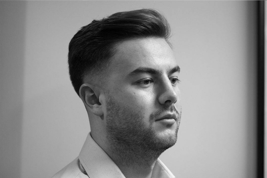 man with medium skin fade on sides to haircut