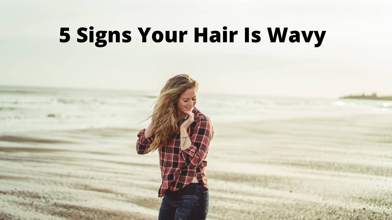 Image of women with wavy hair walking down beach