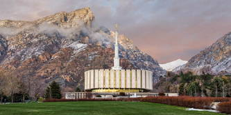 Panoramic picture of the Provo Utah temple against the mountains.