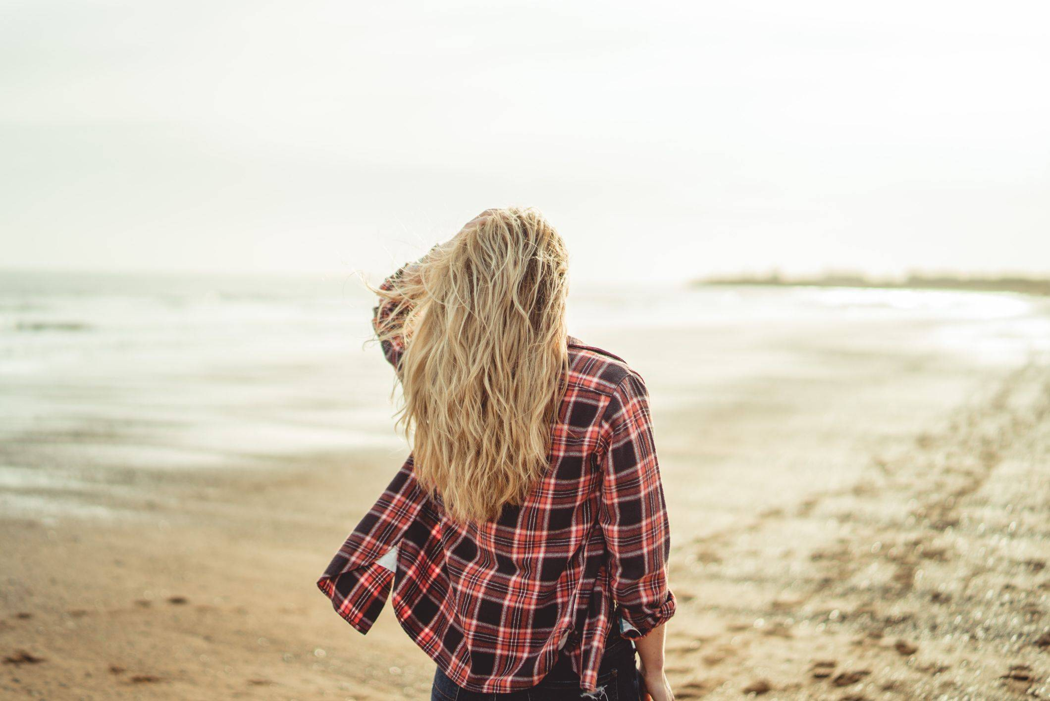 Image of back of wavy hair on beach