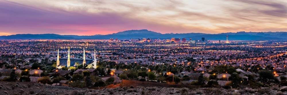 Panoramic photo of the Las Vegas Nevada Temple, surrounding city, and mountains.