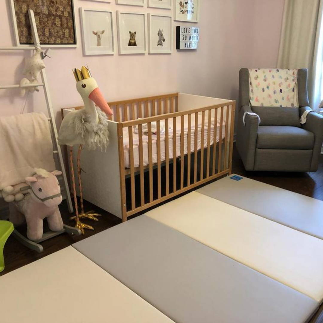 AlZiP playmat in neutral nursery for baby