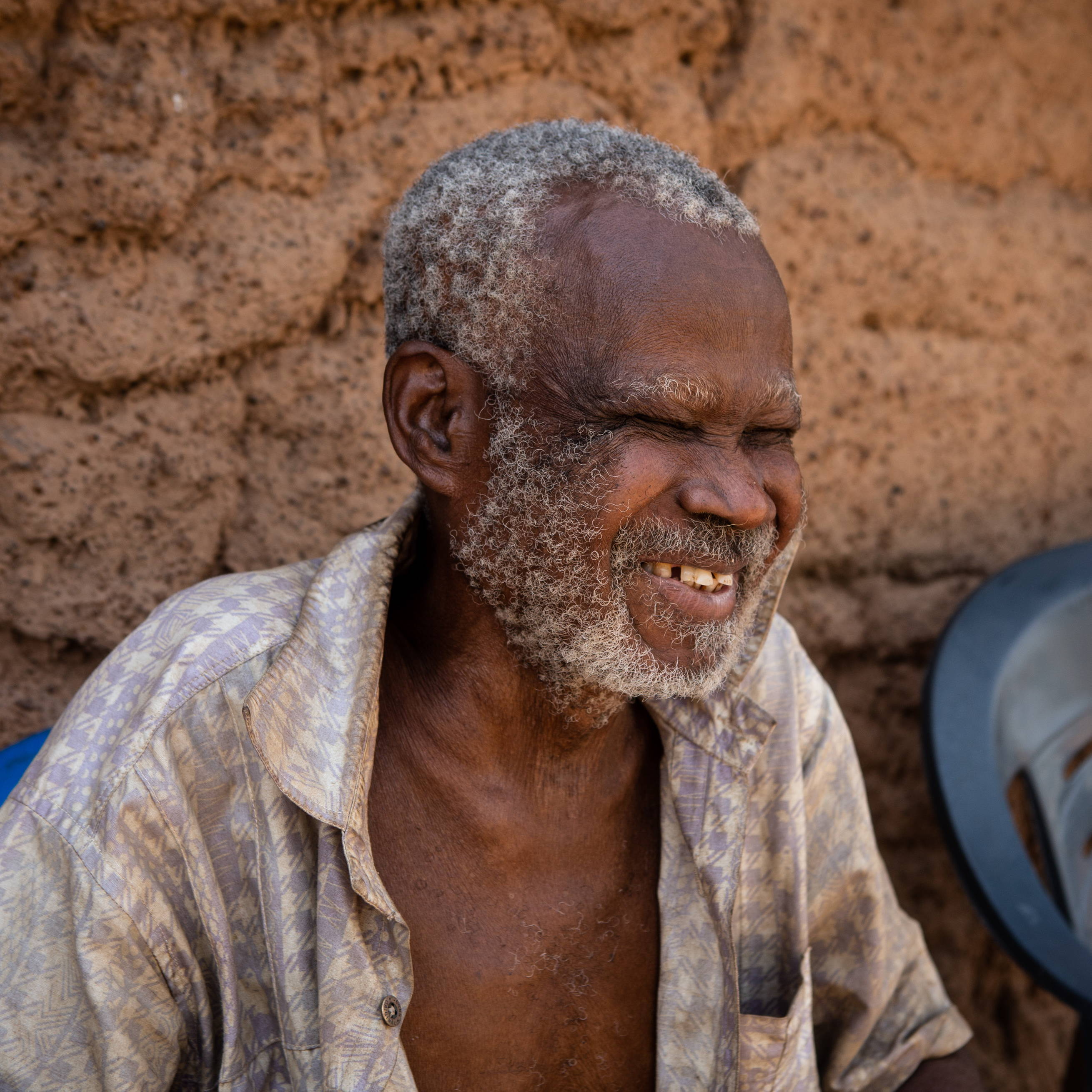 Emmanuel lives in Asubende, he became blind from onchocerciasis at a young age.