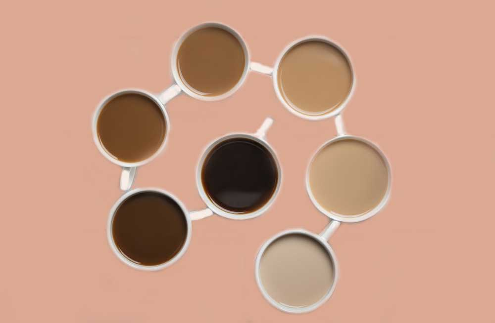 Coffee cups, filled with different hues of creaminess