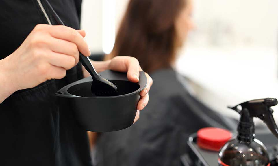 hair colorist mixing color