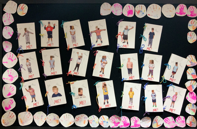 """bulletin board with all of the students and their """"all about me"""" books that they made"""