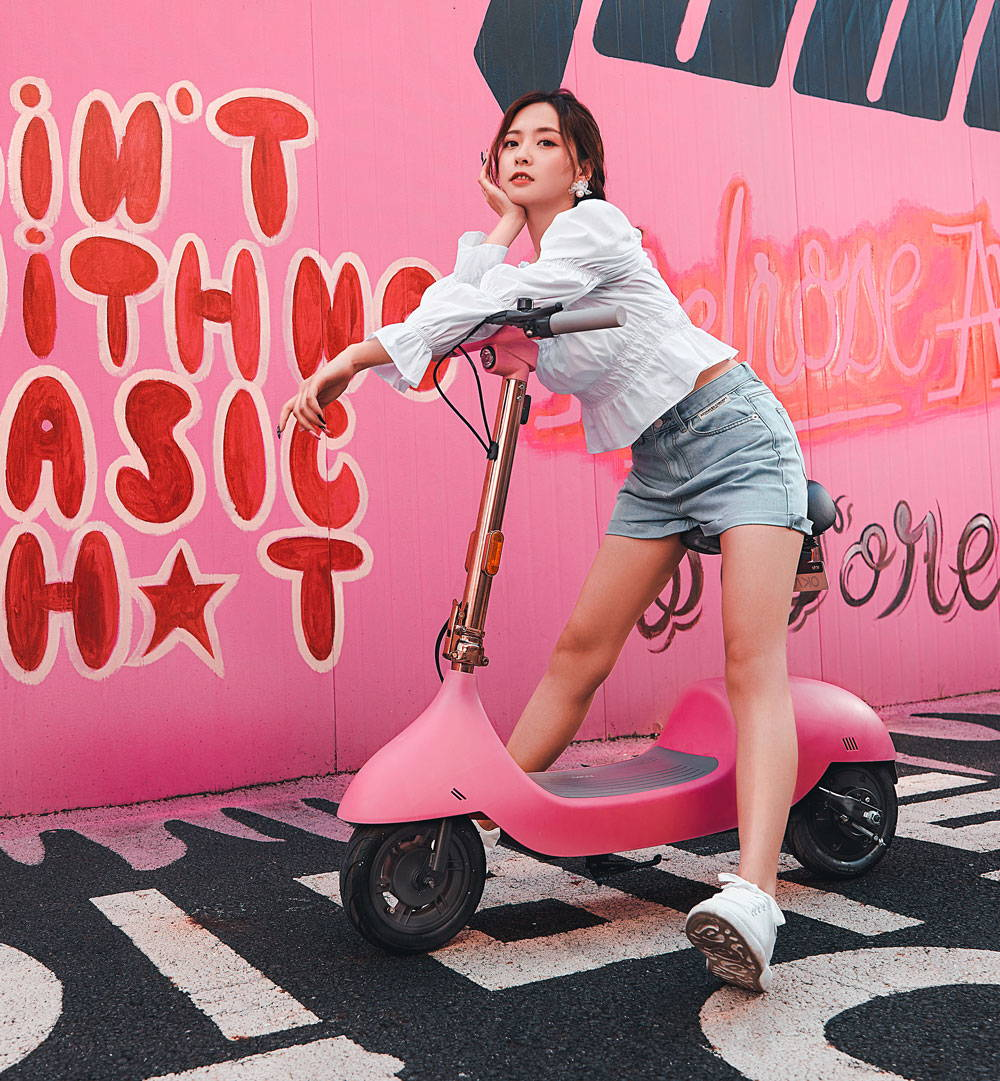 ea10 escooter girl riding pink electric scooter with seat