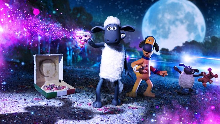 Shaun the Sheep stands holding a glittering slice of pizza in front of a full moon.