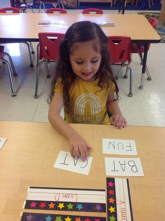 preschool child matching rhyming words at Primrose School of Clear Lake, daycare child care center in Clear Lake, TX, 77062
