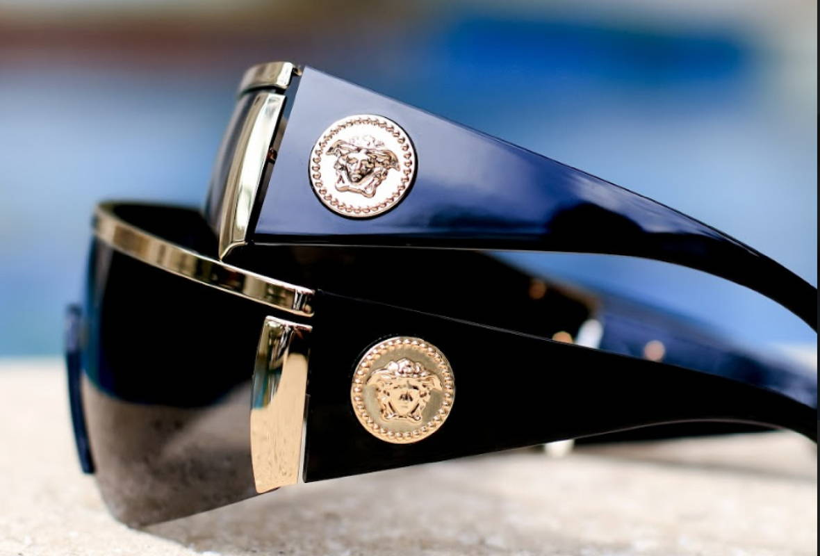 aa2d1cdae926d VE 2197. The Versace VE2197 are a pair of shield sunglasses ...