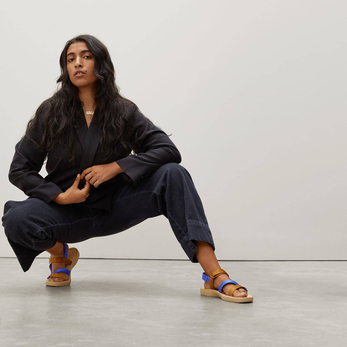A model wears Everlane sandals made from recycled plastic bottles
