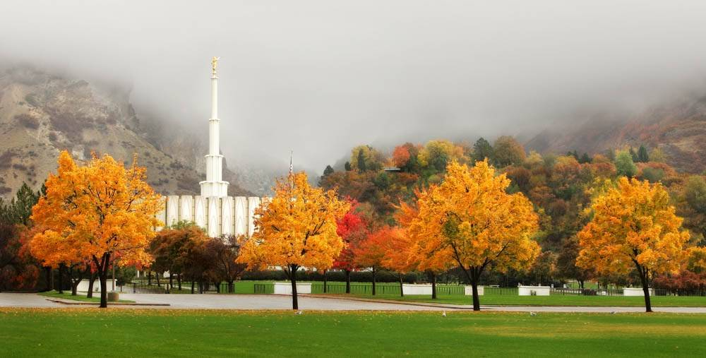 LDS art panoramic photo of the Mt Timpanogos Temple surrounded by fog and fall trees.